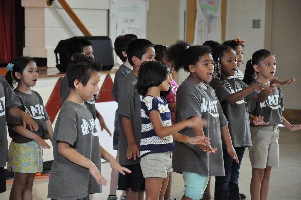 Choir performance at MTR Camp Summer Showcase for the Graham Heights community.